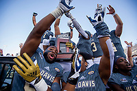 The UC Davis Aggies celebrate after their 56-13 win in the 65th Causeway Classic football game between the Sacramento State Hornets and the UC Davis Aggies at Mackay Stadium at  the University of Reno, Saturday Nov 17, 2018. The game was moved there due to the bad air quality in Sacramento due to the Camp Fire.