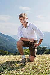 Teenage boy posing outdoors in traditional Bavarian costume, Bavaria, Germany