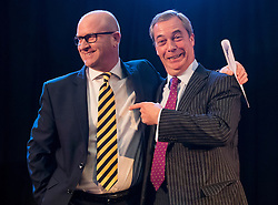 © Licensed to London News Pictures. 28/11/2016. London, UK. New party leader PAUL NUTTALL on stage with Former UKIP leader NIGEL FARAGE following the announcement of the new leader of the UK Independence Party (UKIP), at the Emmanuel Centre in Westminster London.. Photo credit: Ben Cawthra/LNP