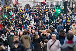 © Licensed to London News Pictures. 12/12/2020. London, UK. Christmas shoppers in Regent Street on a busy Saturday afternoon. London is currently under Tier 2 Covid restrictions and could be facing Tier 3 as the Covid-19 case rate has been the highest in the UK. Photo credit: Ray Tang/LNP