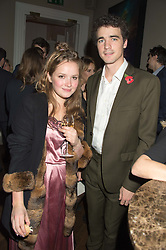 ARTHUR GUINNESS and POSY WOOD at the Tatler Little Black Book Party at Home House Member's Club, Portman Square, London supported by CARAT on 11th November 2015.