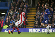 Mame Biram Diouf of Stoke city finishes and scores  but sees his 'goal' ruled out for offside .<br /> Premier league match, Chelsea v Stoke city at Stamford Bridge in London on Saturday 30th December 2017.<br /> pic by Kieran Clarke, Andrew Orchard sports photography.