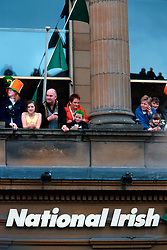 IRELAND DUBLIN 17MAR00 - Dublin residents observe the festivities from a window on O'Connell Street during St. Patrick's Day celebrations...jre/Photo by Jiri Rezac..© Jiri Rezac 2000..Contact: +44 (0) 7050 110 417.Mobile:  +44 (0) 7801 337 683.Office:  +44 (0) 20 8968 9635..Email:   jiri@jirirezac.com.Web:     www.jirirezac.com..© All images Jiri Rezac 2000 - All rights reserved.