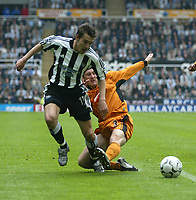Photo. Andrew Unwin.<br /> Newcastle United v Wolverhampton Wanderers, FA Barclaycard Premier League, St James Park, Newcastle upon Tyne 09/05/2004.<br /> Newcastle's Darren Ambrose (l) looks to evade a challenge from Wolves' Lee Naylor (r).