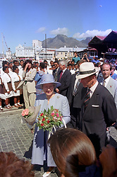 Queen Elizabeth II and the Duke of Edinburgh meet residents of Cape Town, South Africa, during a walkabout on the dockside, en route to the Royal Yacht Britannia.