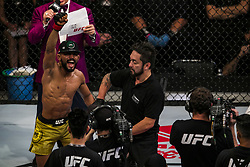 October 28, 2017 - Sao Paulo, Sao Paulo, Brazil - Oct, 2017 - Sao Paulo, Sao Paulo, Brazil - Fight between DEIVESON ALCANTARA and JARRED BROOKS (The Monkey God) during UFC Fight Night, at the Ibirapuera Gymnasium in Sao Paulo, this Saturday (28). DEIVESON (in yellow) won. (Credit Image: © Marcelo Chello/CJPress via ZUMA Wire)