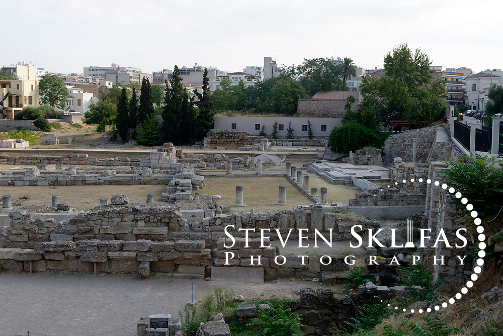 General view of the Pompeion, centre of image. Kerameikos. Athens. Greece. The Pompeion was a public building used for preparation of festivals and processions, including the annual Panathenaic procession. The original building dates from the 4th century BC and consisted of an inner colonnaded court with several side rooms and a monumental entrance gate (Propylon). The building is located between the Sacred gate (on left) and the Dipylon Gate to the right. Serving as a burial ground as long ago as the 12th century BC, Kerameikos located in the ancient neighbourhood of potters contains part of the ancient city walls and the Dipylon, the main gate of Ancient Athens at a junction of the Sacred Way and Panathenaic Way. It served as a burial ground for the richest and most distinguished citizens of the city.