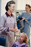 """Sept 8, 2008 -- COLORADO CITY, AZ: A woman in the Jessop family, polygamist members of the FLDS, grooms some of the children who live in their home in Colorado City, AZ. Colorado City and the neighboring town of Hildale, UT, are home to the Fundamentalist Church of Jesus Christ of Latter Day Saints (FLDS) which split from the mainstream Church of Jesus Christ of Latter Day Saints (Mormons) after the Mormons banned what they call """"Celestial Marriage"""" (polygamy) in 1890 so that Utah could gain statehood into the United States. The FLDS Prophet (leader), Warren Jeffs, has been convicted in Utah of """"rape as an accomplice"""" for arranging the marriage of teenage girl to her cousin and is currently on trial for similar, those less serious, charges in Arizona. After Texas child protection authorities raided the Yearning for Zion Ranch, (the FLDS compound in Eldorado, TX) many members of the FLDS community in Colorado City/Hildale fear either Arizona or Utah authorities could raid their homes in the same way. Older members of the community still remember the Short Creek Raid of 1953 when Arizona authorities using National Guard troops, raided the community, arresting the men and placing women and children in """"protective"""" custody. After two years in foster care, the women and children returned to their homes. After the raid, the FLDS Church eliminated any connection to the """"Short Creek raid"""" by renaming their town Colorado City in Arizona and Hildale in Utah. The Jessops are a polygamous family and members of the FLDS.   Photo by Jack Kurtz / ZUMA Press"""