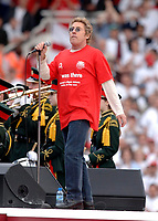 Photo: Daniel Hambury.<br />Arsenal v Wigan Athletic. The Barclays Premiership. 07/05/2006.<br />Former frontman of 'The Who' Roger Daltrey performs at the end of the game.