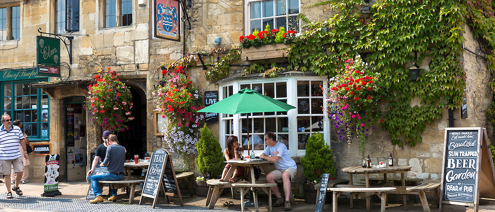 Tourists at The Cotswolds Arms inn traditional old gastro pub in Burford in The Cotswolds, Oxfordshire, UK