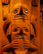 Faces on one of the The Dogfish Houseposts, Xa'tgu Ga'as, carved by Steve Brown, Wayne Price and Will Bulkhardt to replicate original houseposts carved in the late 1700s, Chief Shakes Tribal House, Wrangell, Alaska.