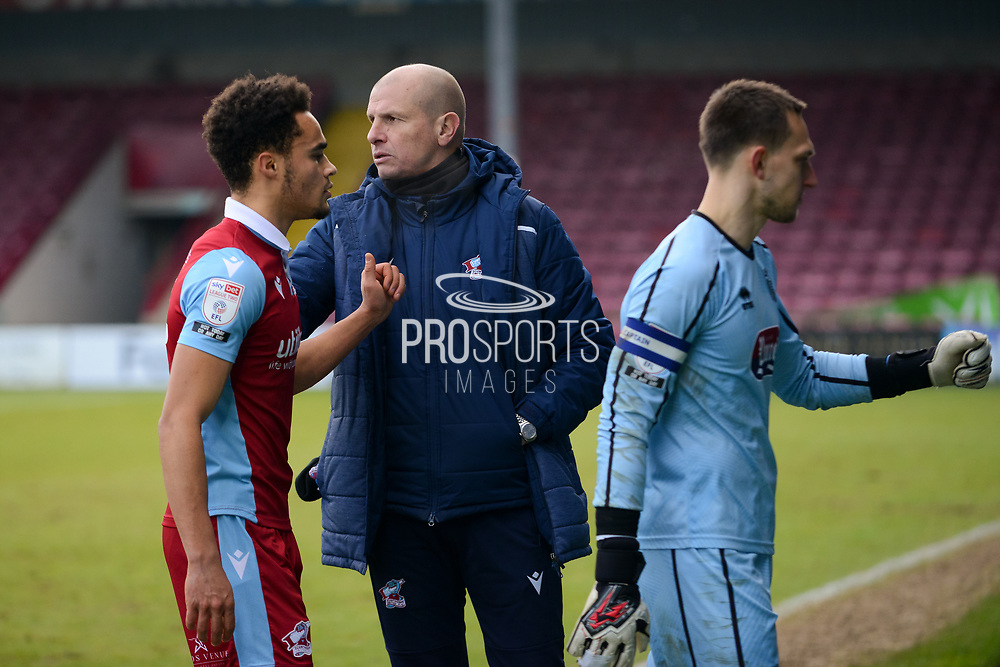 Scunthorpe United manager Neil Cox congratulating Scunthorpe United Jai Rowe (25) during the EFL Sky Bet League 2 match between Scunthorpe United and Grimsby Town FC at the Sands Venue Stadium, Scunthorpe, England on 23 January 2021.
