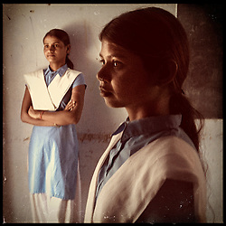 """iPhone portrait of (L-R) Choti Bairwa, 15, and Jyoti Bairwa, 12, in a village of Rajasthan, India, April 3, 2013. """"To other girls like me, I would like to say that don't get married at a young age. Because it is harmful. It is harmful,"""" said one girl.<br />  <br /> Under Indian law, children younger than 18 cannot marry. Yet in a number of India's states, at least half of all girls are married before they turn 18, according to statistics gathered in 2012 by the United Nations Population Fund (UNFPA). However, young girls in the Indian state of Rajasthan—and even a few boys—are getting some help in combatting child marriage. In villages throughout Tonk, Jaipur and Banswara districts, the Center for Unfolding Learning Potential, or CULP, uses its Pehchan Project to reach out to girls, generally between the ages of 9 and 14, who either left school early or never went at all. The education and confidence-building CULP offers have empowered young people to refuse forced marriages in favor of continuing their studies, and the nongovernmental organization has provided them with resources and advocates in their fight."""
