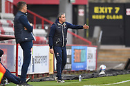 Cheltenham Town manager Michael Duff  in the technical area pointing, directing, signalling, gesture during the EFL Sky Bet League 2 match between Stevenage and Cheltenham Town at the Lamex Stadium, Stevenage, England on 20 April 2021.