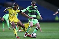 Forest Green Rovers Dayle Grubb(8) holds off Oxford United's Curtis Nelson(5) during the The FA Cup 1st round match between Oxford United and Forest Green Rovers at the Kassam Stadium, Oxford, England on 10 November 2018.