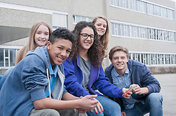 University students sitting in campus and smiling, Bavaria, Germany