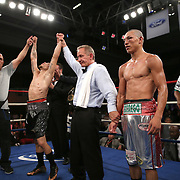 """Jonathan """"Polvo"""" Oquendo (black shorts) celebrates after defeating Guillermo """"El Borrego"""" Avila for the WBO Latin Featherweight title during the """"Boxeo Telemundo"""" boxing match between at the Kissimmee Civic Center on Friday, March 14, 2014 in Kissimmme, Florida.  Oquendo won the fight by unanimous decision. (AP Photo/Alex Menendez)"""