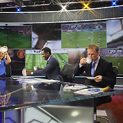 A lighthearted moment off air as NBC Sports Network presenters Rebecca Lowe, Robbie Earle, and Robbie Mustoe, (right), with their tea cups in the NBC Sports Network studios in Stamford, Connecticut, during Saturday morning live broadcasts of English Premier League games. Stamford,  Connecticut, USA. 21st September 2013. Photo Tim Clayton