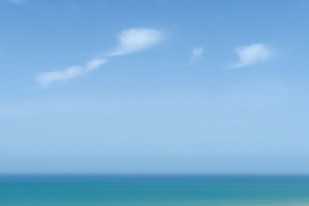 Abstract sea with cloudy blue sky at the Atlantic coast, Morocco.