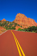 Sandstone cliff and red road in Kolob Canyons, Zion National Park, Utah