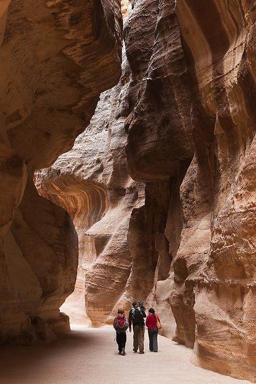 Members of the Leshem family, from Israel, walk down Al Siq, the slot canyon entrance to Petra, Jordan.