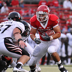 Sep 7, 2009; Piscataway, NJ, USA;  Rutgers running back Joe Martinek (38) avoids a tackler during the second half as Cincinnati defeats Rutgers 47-15 in NCAA Big East football at Rutgers Stadium.