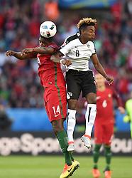 William Carvalho of Portugal battles for the high ball with  David Alaba of Austria - Mandatory by-line: Joe Meredith/JMP - 18/06/2016 - FOOTBALL - Parc des Princes - Paris, France - Portugal v Austria - UEFA European Championship Group F