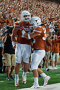 AUSTIN, TX - AUGUST 30:  David Ash #14 of the Texas Longhorns celebrates after rushing for a 1 yard touchdown against the North Texas Mean Green during the 2nd quarter on August 30, 2014 at Darrell K Royal-Texas Memorial Stadium in Austin, Texas.  (Photo by Cooper Neill/Getty Images) *** Local Caption *** David Ash