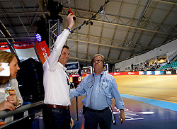 A guest fires the starter's pistol before the Men's Keirin Final during day one of the Six Day Series Manchester at the HSBC UK National Cycling Centre.