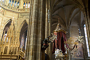 The interior of St Vitas Cathedral in Prague Castle, on 18th March, 2018, in Prague, the Czech Republic. The Metropolitan Cathedral of Saints Vitus, Wenceslaus and Adalbert is a Roman Catholic metropolitan cathedral in Prague, the seat of the Archbishop of Prague. Until 1997, the cathedral was dedicated only to Saint Vitus, and is still commonly named only as St. Vitus Cathedral. This cathedral is a prominent example of Gothic architecture and is the largest and most important church in the country. It is located within Hradcany-Prazsky Hrad Prague Castle in the Czech capital.