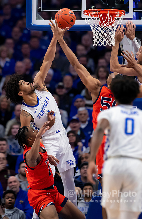 LEXINGTON, KY - FEBRUARY 29: Nick Richards #4 of the Kentucky Wildcats shoots the ball against Austin Wiley #50 of the Auburn Tigers during the first half at Rupp Arena on February 29, 2020 in Lexington, Kentucky. (Photo by Michael Hickey/Getty Images) *** Local Caption *** Nate Sestina; Austin Wiley