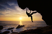 Kevin Jorgesen bouldering at sunset on the craggy Sonoma County coastline in Northern California.