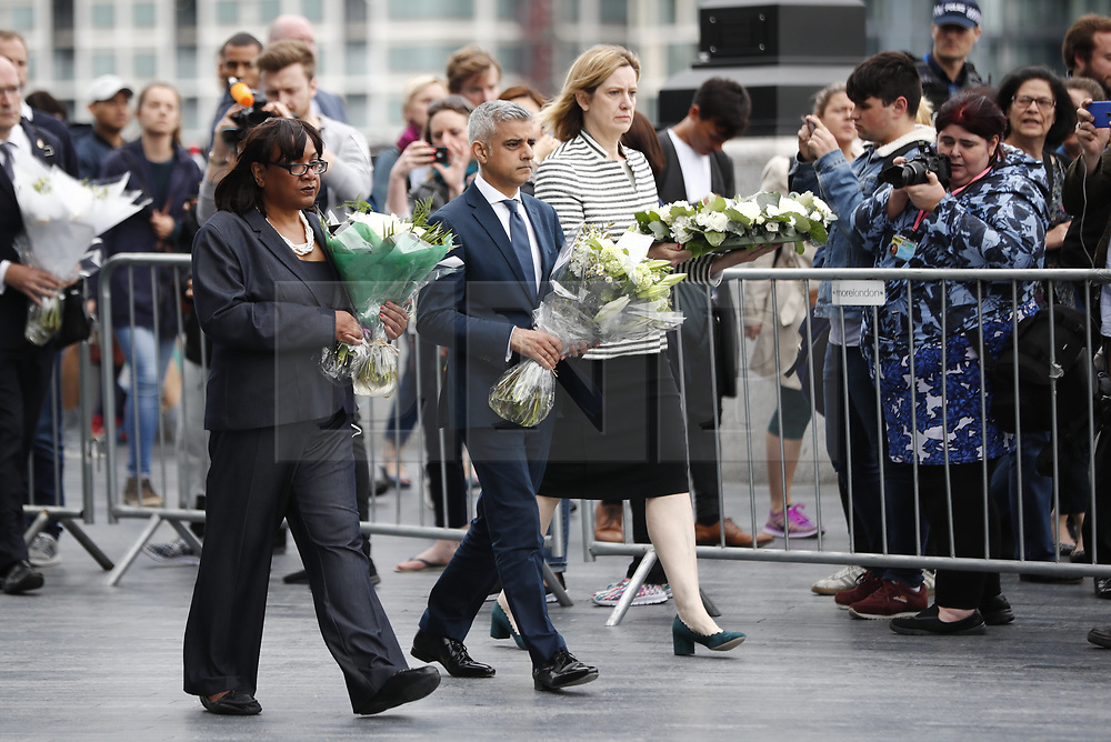 © Licensed to London News Pictures. 05/06/2017. London, UK.        Shadow Home Secretary DIANNE ABBOTT, Mayor of London SADIQ KHAN and Home Secretary AMBER RUDD lays wreaths ahead of a vigil at Potters Fields Park outside City Hall in London for those who lost their lives in the London Bridge terror attack.  Three men attacked members of the public  after a white van rammed pedestrians on London Bridge. Ten people including the three suspected attackers were killed and 48 injured in the attack. Photo credit: Tolga Akmen/LNP