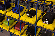"50-70,000 pieces of British Airways baggage a day travel through 11 miles of conveyor belts which were installed in a 5-storey underground hall beneath the 400m (a quarter of a mile) length of Terminal 5 at Heathrow Airport. Here we see items of luggage spending 4 hours in transit, held in a fully-automated parking lot for bags. Computers decide when to fish the item out and re-introduce it into the system and load it on to the appropriate aircraft. T5 alone has the capacity to serve around 30 million passengers a year and was completed in 2008 at a cost of £4.3bn. The system was designed by an integrated team from the airport operator BAA, BA and Vanderlande Industries of the Netherlands, and handles both intra-terminal and inter-terminal luggage. From writer Alain de Botton's book project ""A Week at the Airport: A Heathrow Diary"" (2009)."