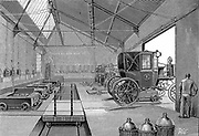 Depot at Rue Cardinet where electrically driven Paris cabs were fitted with freshly charged batteries. At front right are glass carboys in protective wicker jackets. These contained acid used in batteries  From 'La Nature' Paris 1899.