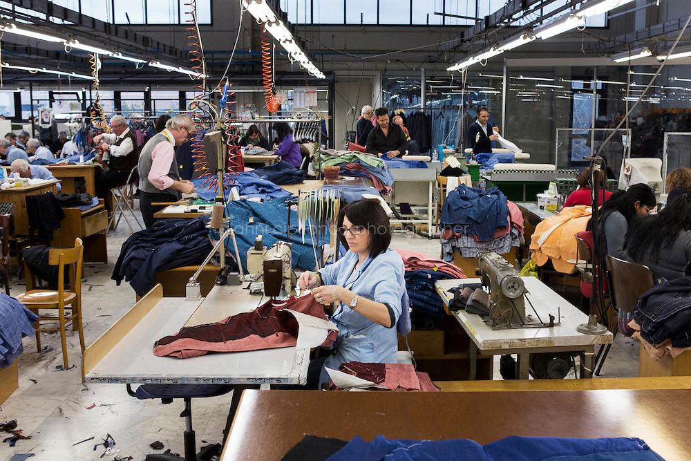 ARZANO, ITALY - 16 January 2014: A tailor work on a blazer at the  Kiton factory in Arzano, Italy, on January 16th 2014.