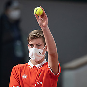 PARIS, FRANCE October 07. A ball boy presenting a Wilson tennis ball to Novak Djokovic of Serbia during his match against Pablo Carreno Busta of Spain in the Quarter Finals of the singles competition on Court Philippe-Chatrier during the French Open Tennis Tournament at Roland Garros on October 7th 2020 in Paris, France. (Photo by Tim Clayton/Corbis via Getty Images)
