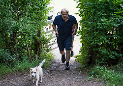 © Licensed to London News Pictures. 29/07/2020. London, UK. British Prime Minister BORIS JOHNSON is seen jogging on a public footpath with his dog Dilyn near Chequers, his grace and favours country residence. PM Johnson has announced a government campaign to cut the country's obesity rates as part of its response for fight COVID-19. Photo credit: Ben Cawthra/LNP