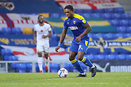 AFC Wimbledon defender Darnell Johnson (27) dribbling during the EFL Sky Bet League 1 match between AFC Wimbledon and Milton Keynes Dons at Plough Lane, London, United Kingdom on 30 January 2021.