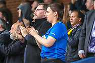 AFC Wimbledon fan clapping during the EFL Sky Bet League 1 match between AFC Wimbledon and Gillingham at the Cherry Red Records Stadium, Kingston, England on 23 March 2019.