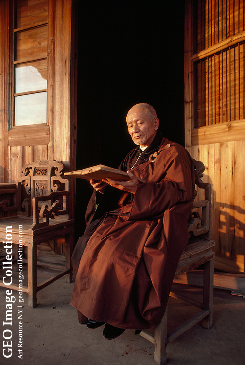 Buddhist monk reading scriptures at the Kaiyuan Temple.