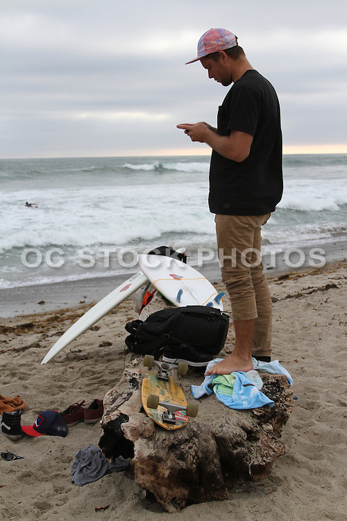 Local Surfer on the Beach Texting