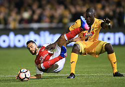 20 February 2017 - The FA Cup - (5th Round) - Sutton United v Arsenal - Theo Walcott of Arsenal tangles with Kevin Amankwaah of Sutton United - Photo: Marc Atkins / Offside.