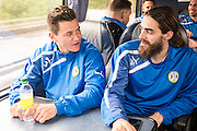 James Jennings and Rob Sinclair on the team bus for Forest Green Rovers Football Club Familiarisation visit to Wembley Stadium, London, England on 10 May 2016. Photo by Shane Healey.