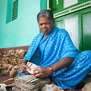 CAPTION: Doddamma is almost completely blind. Her local self-help group (SHG) helped her come together with a small number of other blind women to form an income-generating group. After each contributed an upfront investment to enable them to buy the raw materials they needed, they started making banana leaf bowls to satisfy the demand of street food vendors. LOCATION: Hullepura (village), Kasaba (hobli), Chamrajnagar (district), Karnataka (state), India. INDIVIDUAL(S) PHOTOGRAPHED: Doddamma.