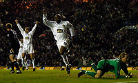 Photo. Jed Wee, Digitalsport.<br /> Leeds United v Leicester City, FA Barclaycard Premiership, Elland Road, Leeds. 05/04/2004.<br /> Leeds' Michael Duberry (C) scores the opening goal.