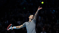 Tennis - 2019 Nitto ATP Finals at The O2 - Day One<br /> <br /> Singles Group Bjorn Borg: Roger Federer (Switzerland) vs. Dominic Thiem (Austria)<br /> <br /> Dominic Thiem (Austria) serves in the first set on his way to taking it <br /> <br /> COLORSPORT/DANIEL BEARHAM