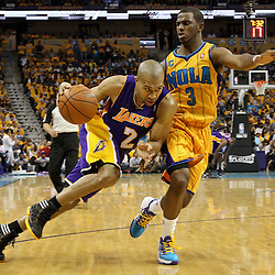 April 22, 2011; New Orleans, LA, USA; Los Angeles Lakers point guard Derek Fisher (2) drives past New Orleans Hornets point guard Chris Paul (3) during the third quarter in game three of the first round of the 2011 NBA playoffs at the New Orleans Arena. The Lakers defeated the Hornets 100-86.   Mandatory Credit: Derick E. Hingle