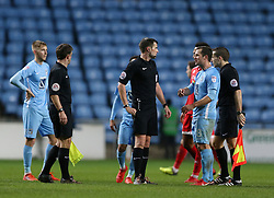 Coventry City's captain Michael Doyle has words with referee Craig Hicks at the end of the match against Crawley Town