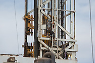 Oilfield worker on a fracking rig in Midland, Texas, in the Permian Basin. The fracking industry recently revived production in the area.
